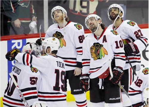 jyo21: My absolute favorite pic from the game after Kaner's OT winning goal