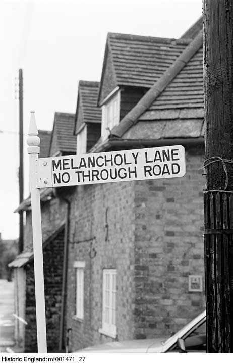 MF001471/27 A road sign reading 'Melancholy Lane No Through Road' with a group of cottages behind PlaceMelancholy Lane, Arne, Dorset    Date1975 - 1989 Photographer: John Gay
