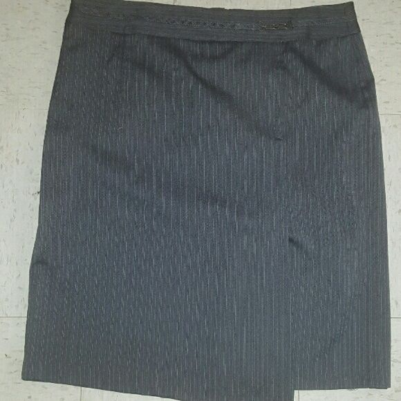 United Colors of Benetton gray pencil skirt Excellent condition. Gray with light blue pin stripes. Zipper in back. Slit in front. Knee length. Size 48 . Check United Colors of Benetton for size chart.  Italian sizes. I would say equivalent to a Large. United Colors Of Benetton Skirts Pencil