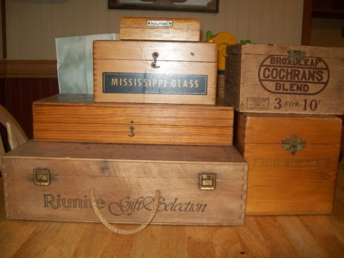 Wooden cigar boxes - They are always handy to store things in, look cool, and last forever. Deeper ones seem to be more useful. Any cigar shop usually has cheap ones, or ebay is a great place to get them.
