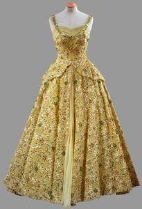 Lime green gown with crinoline skirt heavily embroidered with beads and sequins    Norman Hartnell  Worn by Queen Elizabeth II