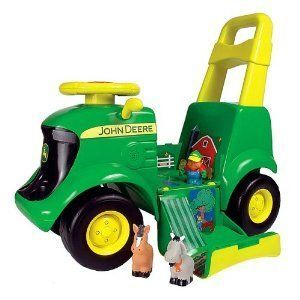 John Deere Sit-N-Scoot Activity Tractor by Learning Curve, http://www.amazon.com/dp/B00080VMF4/ref=cm_sw_r_pi_dp_QEDirb10P6DH9