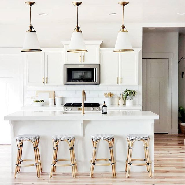 white kitchen with gold hardware coastal black and white barstools gold cone pendants kitche on kitchen remodel gold hardware id=81020