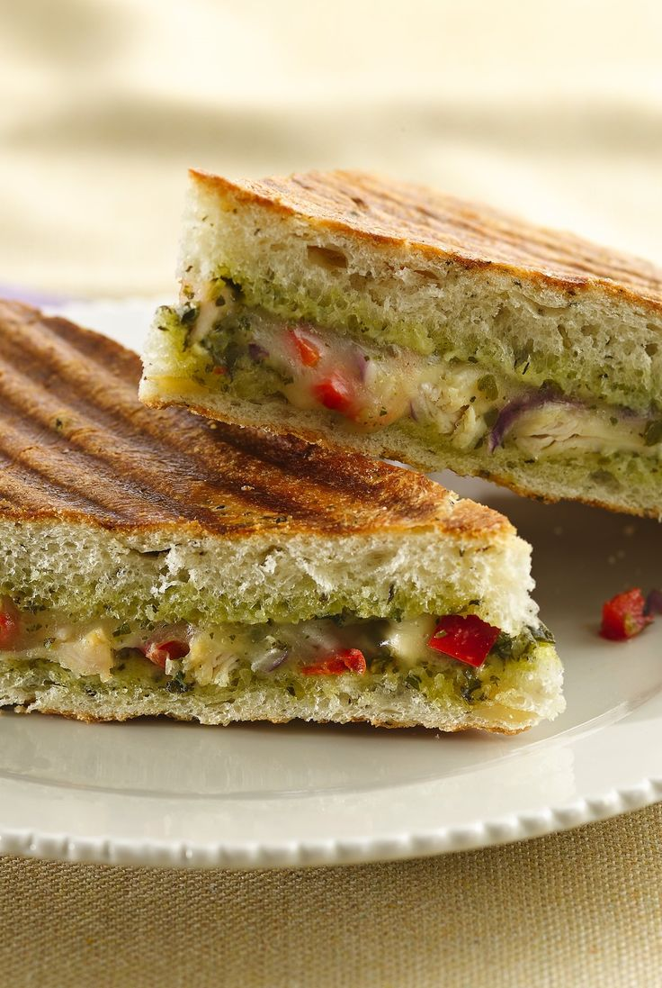 Basil pesto dresses up this Italian-inspired panini stuffed with chicken breast, bell peppers and provolone cheese, sandwiched between toasty focaccia.