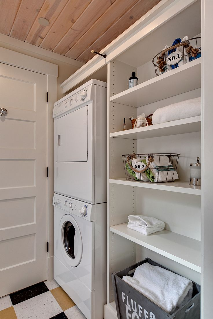 Stack-able washer and dryer conserve space in this lovely cottage.