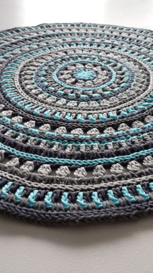 Mandala style place mats - free crochet pattern from Stitches and Supper by Kajsa Hübinette.