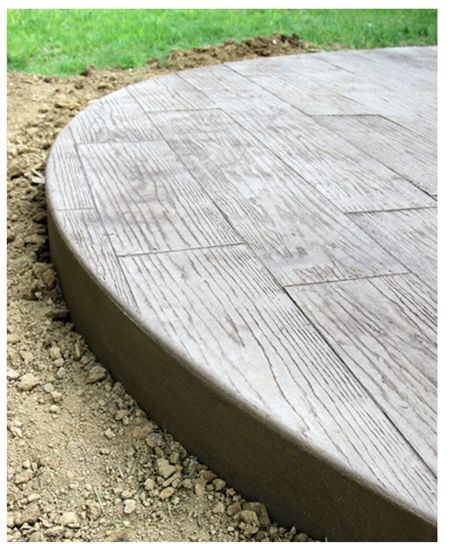 Wood panel stamped concrete patio i 39 m still leaning for Hardwood floor concrete stamp