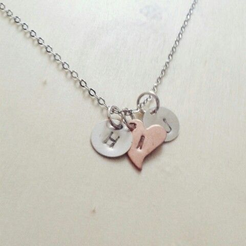 Hand stamped initial charm necklace.