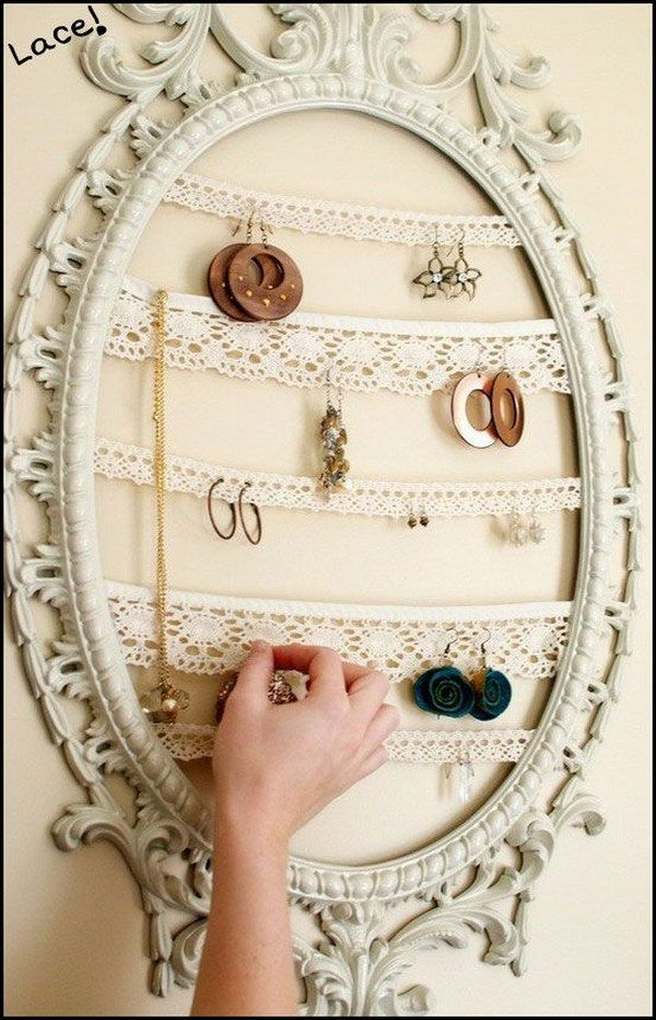 DIY Shabby Chic Jewelry Organizer with ornate frame and lace strips