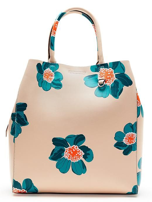 Florals aren't just for your tops and dresses this spring. We're loving this cheerful peach leather tote bag with blue and orange floral print | Banana Republic