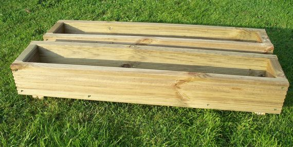 2 x hand made wooden garden decking planters, Made from extra thick 32mm pressure treated tanalised timber The corner are fixed using 2.5 inch, 6.35mm decking screws drainage holes are drilled in the base for drainage the planters are; small 600mm long, 190mm wide and 170mm high ( 2ft x
