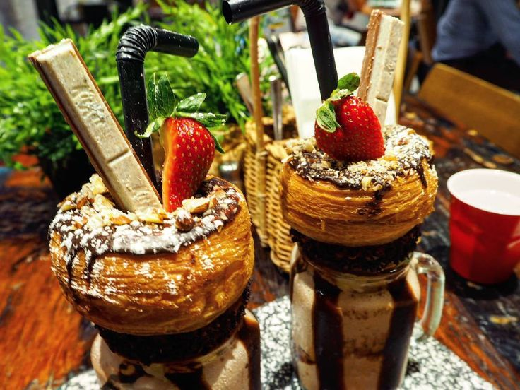 Tucked into these stunning KitKat Kray Shakes from @espressowarriors_mtdruitt! Creamy chocolate frappe swirled with chocolate sauce, a choc hazelnut cronut and served with strawberries and a generous supply of KitKat bars. Yum!