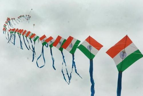 Kids fly kites of the Indian flag to represent their country on Jan  26th which is Republic Day (commemorating Indian Independence from Britain).