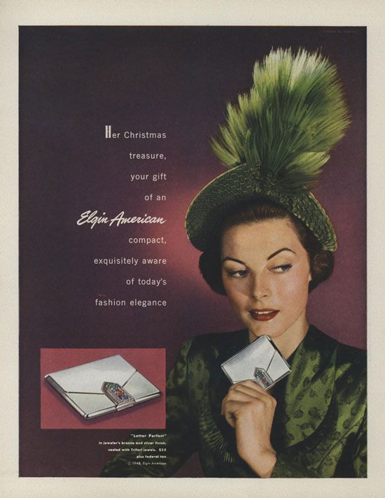 "1948 - TRIFARI - ADS - Her Christmas treasure, your gift of an Elgin American compact, exquisitely aware of today's fashion elegance. ""'Letter Perfect' in jeweler's bronze and silver finish, sealed with Trifari jewels"". Vogue - December 1, 1948"
