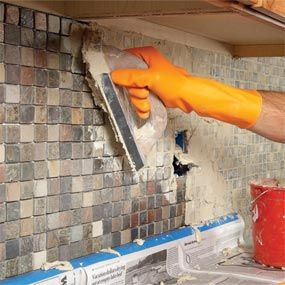 Tiling a backsplash above the counter is one of the easiest ways to upgrade an old, tired kitchen on a tight budget.