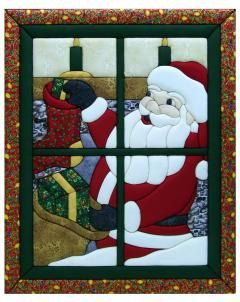 Santa in window quilt magic.