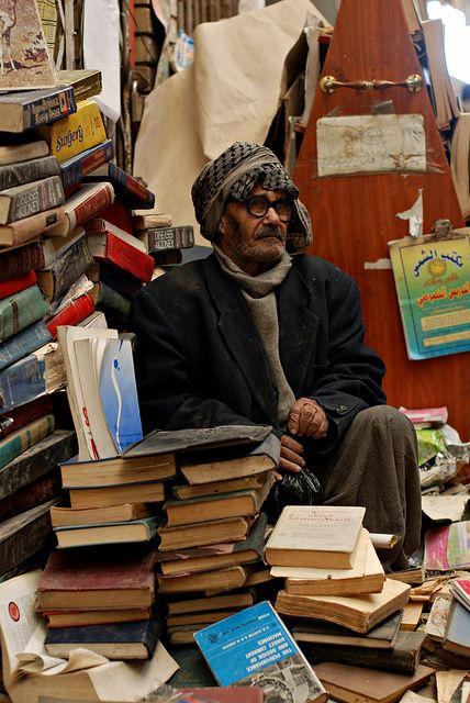"""""""On a Friday last month on my favorite street (Mutanabbi) in Baghdad. I asked the bookseller how old he was and he said 'between 80 and 90'. Mutanabbi is the historic center of Baghdad bookselling, a street filled with bookstores and outdoor book stalls."""" By Samer M, via Flickr"""