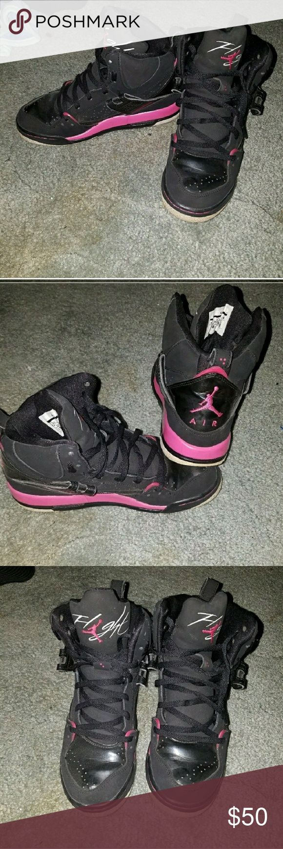 Jordan Air Flights Pink and black air flight jordans.  Worn a few times, no rips, tears, or stains. Laces in great condition. They list a 5.5Y size, but i wear 7.5 and they fit fine. They do not have the strap. Plenty of life left in them. Jordan Shoes Sneakers