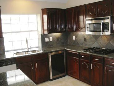 Bombay Mahogany Kitchen With Double Cathedral Style Raised Panel Cabinets Kitchen And Dining