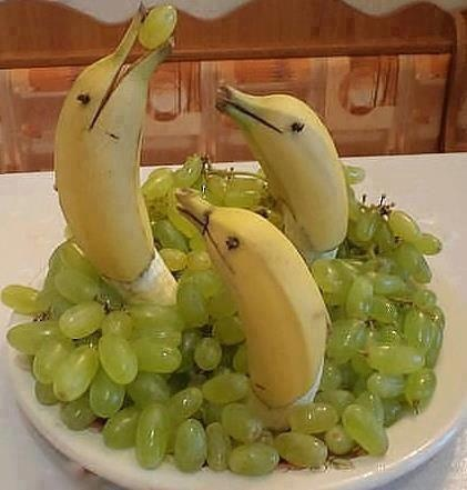 banana dolphins in grapes water