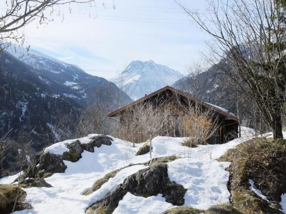 A WW II-era munitions storage building in the Swiss Alps was converted into this modern cabin with a 527 sq ft studio flat