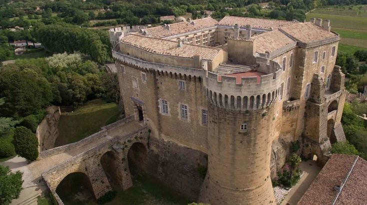 """Suze-la-Rousse, France. This compact and well-defended Medieval castle clings strategically to a large rock high above the surrounding area. During the Renaissance, it was greatly renovated from a more strict fortress to be """"more liveable"""". I'll post more in the comments. : castles"""