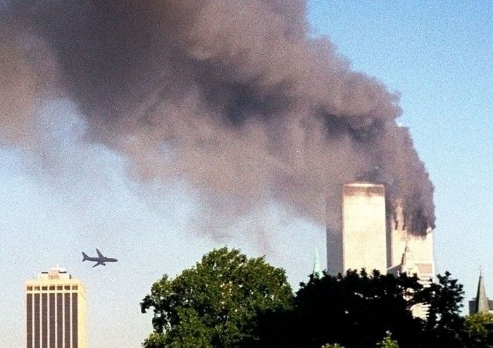 FILE - In this Tuesday, Sept. 11, 2001 file photo, United Airlines Flight 175 approaches the south tower of the World Trade Center in New York moments before collision, seen from the Brooklyn borough of New York. (AP Photo/ William Kratzke) (Credit: AP)