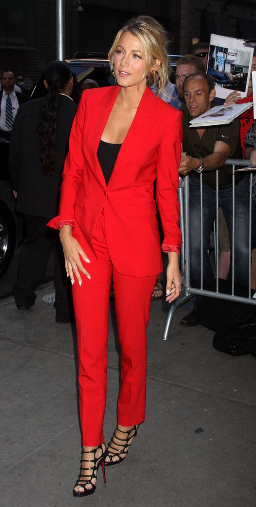 "Blake Lively appears on ""Good Morning America"" show in a Michael Kors suit in a bold, apple-red color."