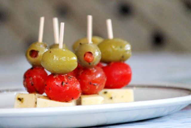 super easy and deliocus marinated cheese, olive, and tomato hors d'oeuvres