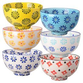 """Bring a pop of style to your luncheon tablescape with this eye-catching stoneware bowl, featuring a chic medallion motif.  Product: Set of 6 bowls Construction Material: StonewareColor: Yellow, blue, white and redFeatures: Medallion motifDimensions: 2.75"""" H x 4.5"""" Diameter"""