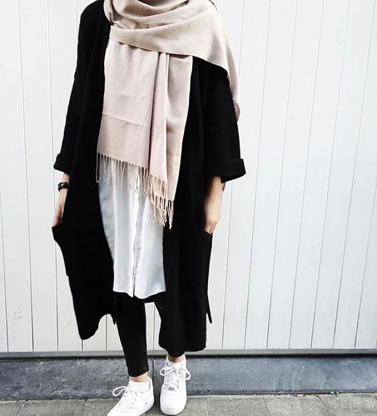 Long black coat + white button down shirt + skinny jeans + white sneakers + beige scarf/hijab