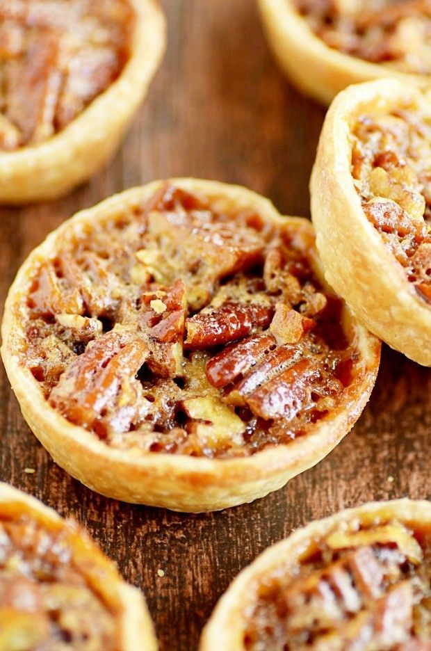 Mini Pecan Pies Recipe made with egg, light corn syrup, sugar, butter, vanilla, chopped pecans and refrigerated pie crust. (Note: use 2 pie crusts to use up all the batter. DO NOT DOUBLE THE PECAN PART! Makes more like 20 pies