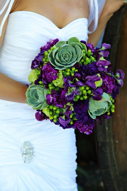 this flower bouquet makes me seriously consider wearing my purple and lime green running shoes at my wedding....all it needs are some peacock feathers