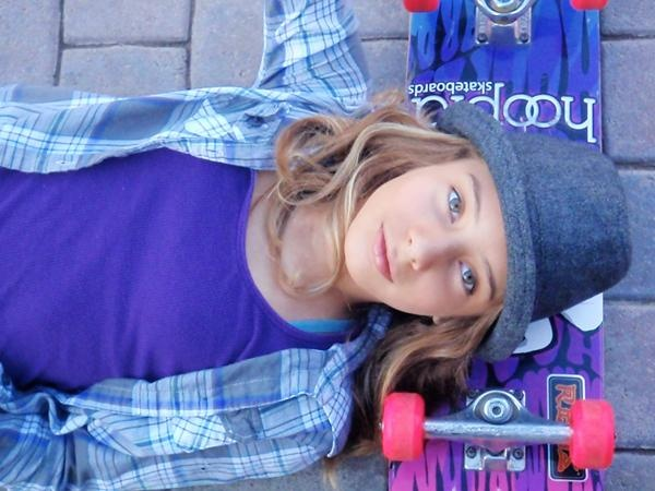 girl skateboarder- bright colors, layers and fedora