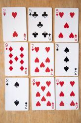Elevens Card Game-Get out a deck of cards and practice finding sums of 11 in this one-player math game! You'll lay out nine cards, then try to find sets of cards that add up to 11.