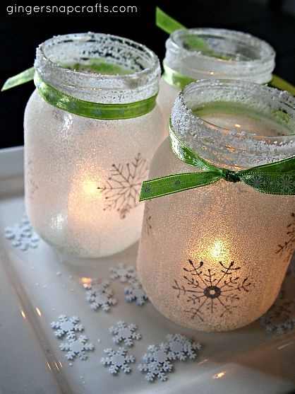 White Christmas Mason Jar Luminaries — stencils, mod podge  salt on the mason jars. #masonjars #masonjarcrafts #masonjarcraftslove