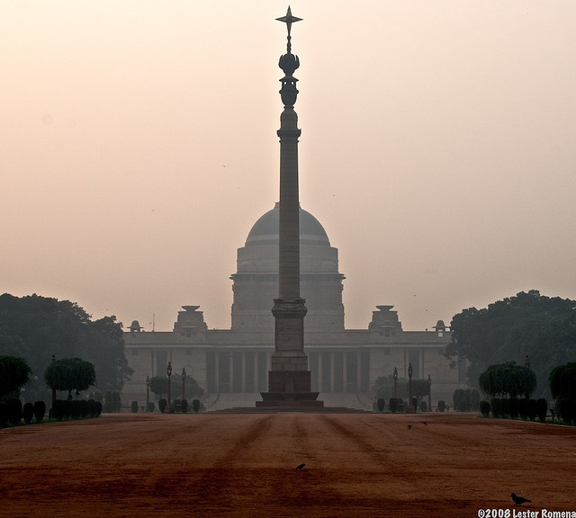 """Rashtrapati Bhavan, New Delhi, India    Rashtrapati Bhavan is Sanskrit for """"Presidential Palace."""" In front of it is the """"Jaipur Column"""", with the Star of India on top. This shot was taken from the gate as you're not allowed to enter the compound."""