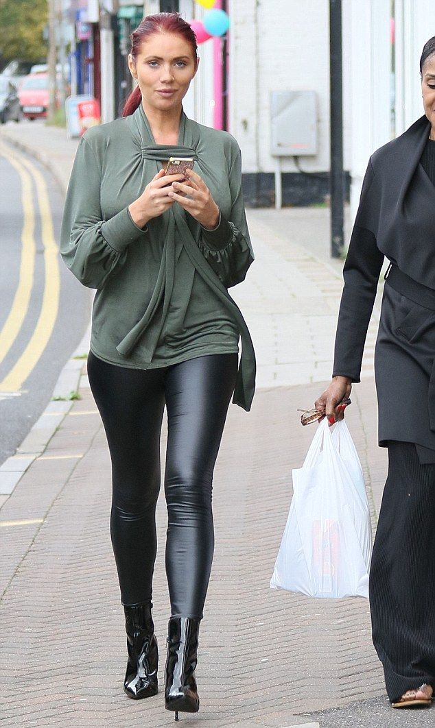 Moving forward: Amy Childs looked chirpy as she left a tattoo and piercing parlour in Essex on Saturday afternoon