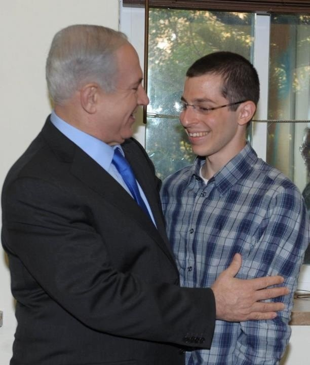 Prime Minister Benjamin Netanyahu meets with recently rescued IDF soldier Gilad Shalit, who had been kidnapped by Hamas and held for 5 years. He is looking much healthier, robust and sun tanned. This photo makes me so happy because I prayed for his safe release. Our prayers were answered thank GOD Yahweh!