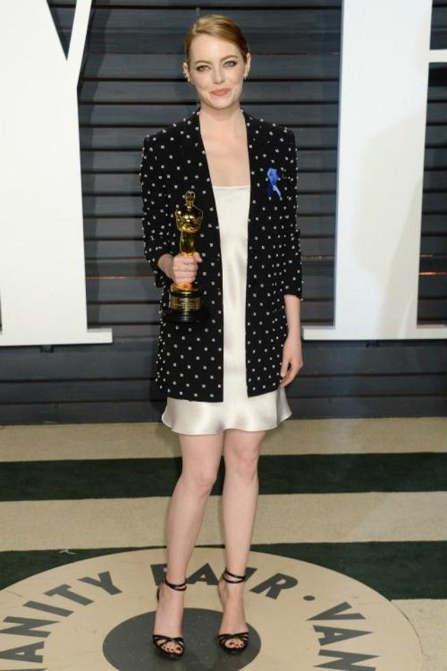 Emma Stone wearing  Givenchy Cross Print Blazer