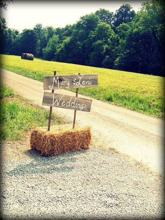 Wedding sign with hay bails. Love this for a farm wedding