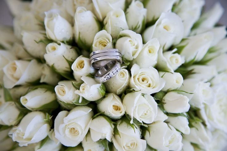 Wedding rings in a bunch of white roses. Simply stunning! Definitely a good photo for any brides looking for ideas!