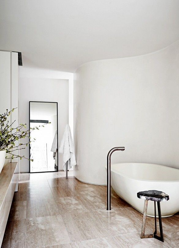 White bathroom with freestanding bathtub