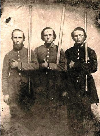 John, Bud and Sam Farris, Co. I, 41st Tennessee Infantry (CSA), with two shotguns and a flintlock. Source.