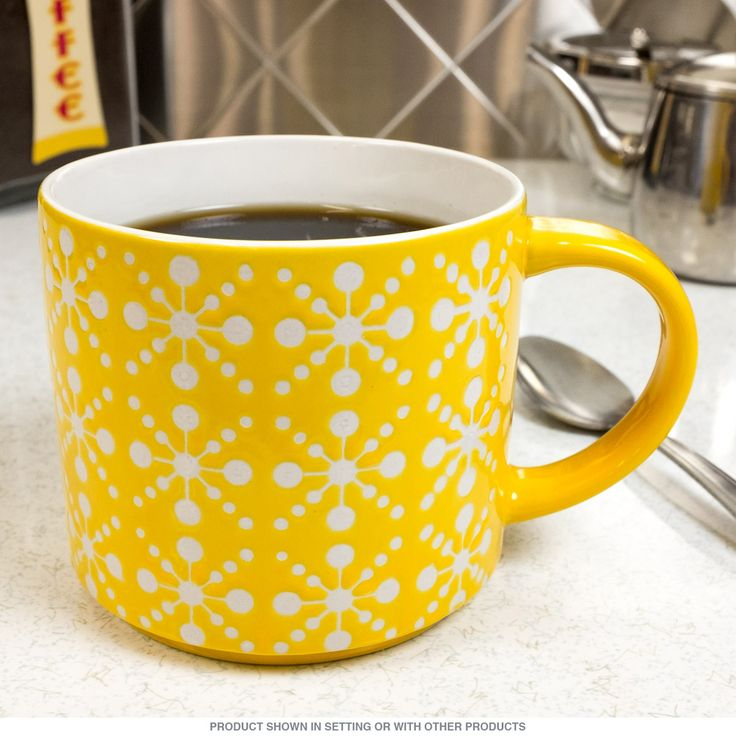 Vintage style stackable coffee mug featuring an attractive retro print for perking up your morning coffee. This kitchen mug is made of high quality porcelain and has a 16 fl. oz. capacity. Dishwasher and microwave safe. Measures 5.5W x 3.5 inches.