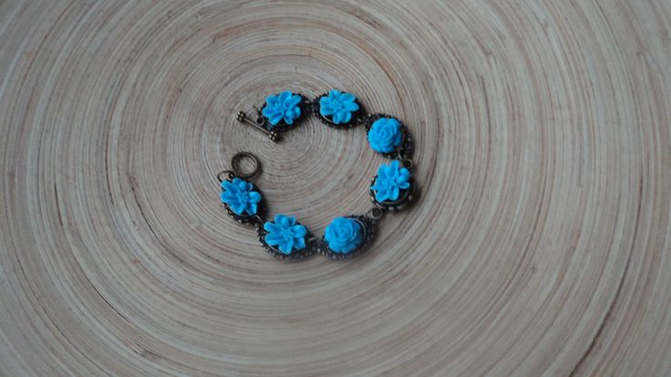 blue roses and orchid bracelet. $10