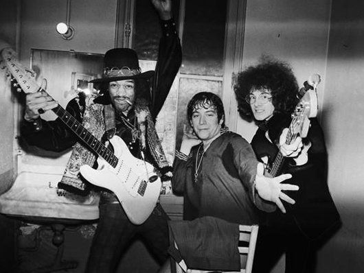 Rock legends Jimi Hendrix and Eric Burdon (from The Animals and War) fool around with the bassist of The Jimi Hendrix Experience, Noel Redding