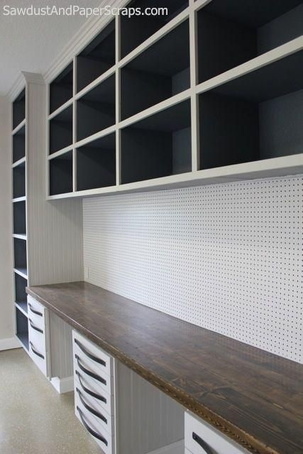 Garage workshop with open storage, drawer storage, peg board for tools, and long wood countertop work bench, from Sawdust Girl