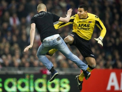 AZ Alkmaar goalkeeper Esteban Alvarado kicked an Ajax fan who tried to attack him during a soccer match at the Amsterdam Arena Wednesday. Mr. Alvarado was given a red card, which was later rescinded. His team left the field; the game might have to be replayed. (Photo: Louis Van De Vuurst / Ajax / Reuters via the Wall Street Journal)