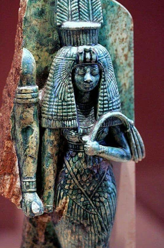 Queen Tiye, whose husband, Amenhotep III, may have been depicted to her right in this broken statue.